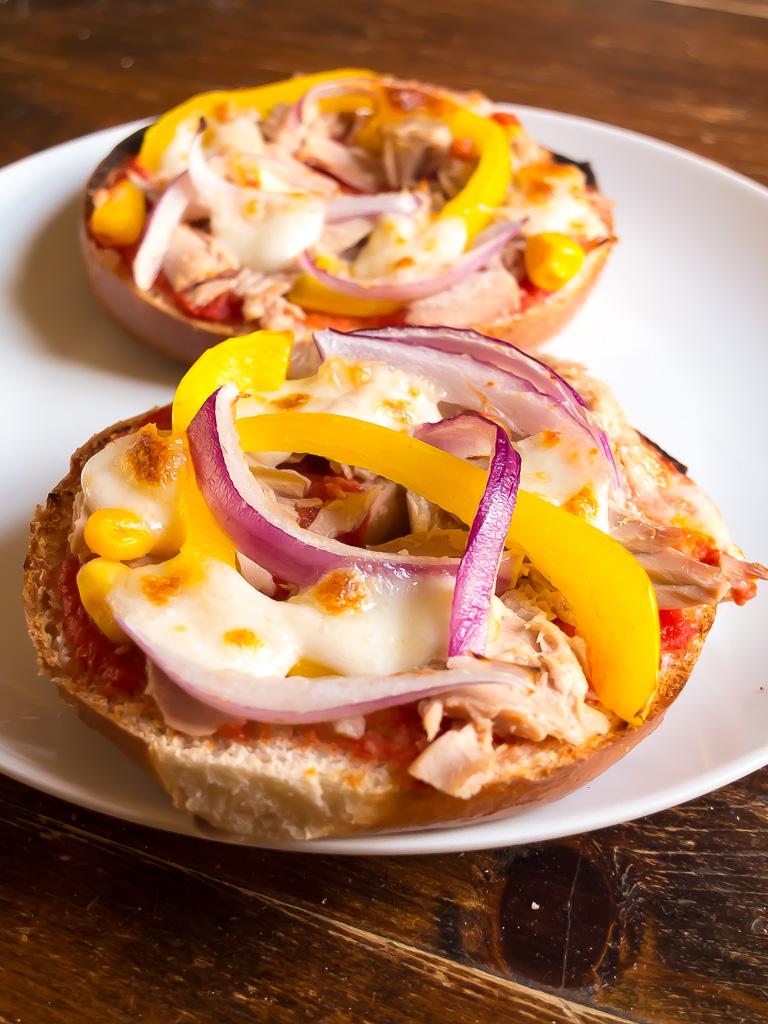 plate with tuna, mozzarella, onion and pepper bagel