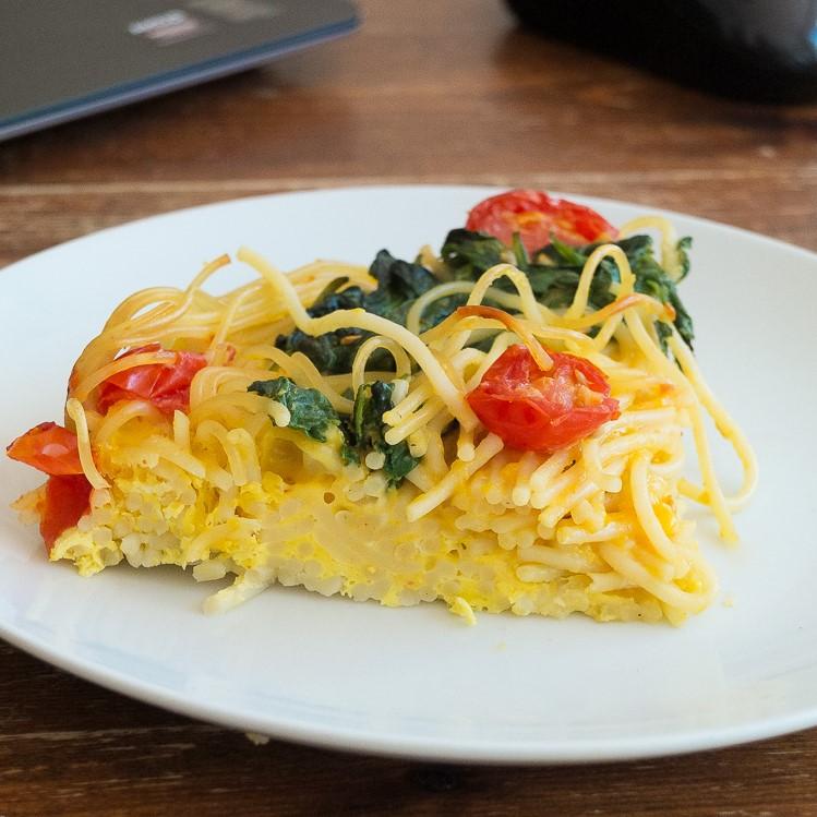 Spaghetti fritatta with tomato and spinach