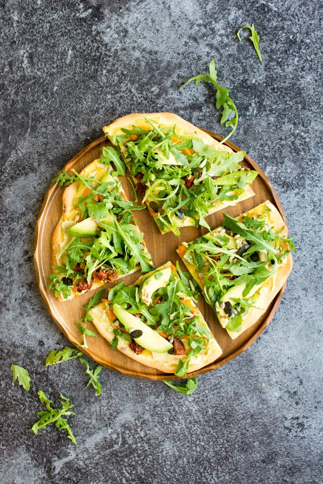 hummus pizza with avocado and rocket