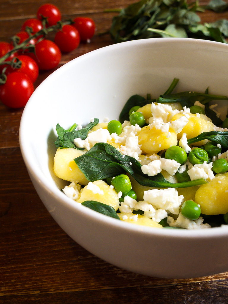 bowl with gnocchi spinach feta and peas