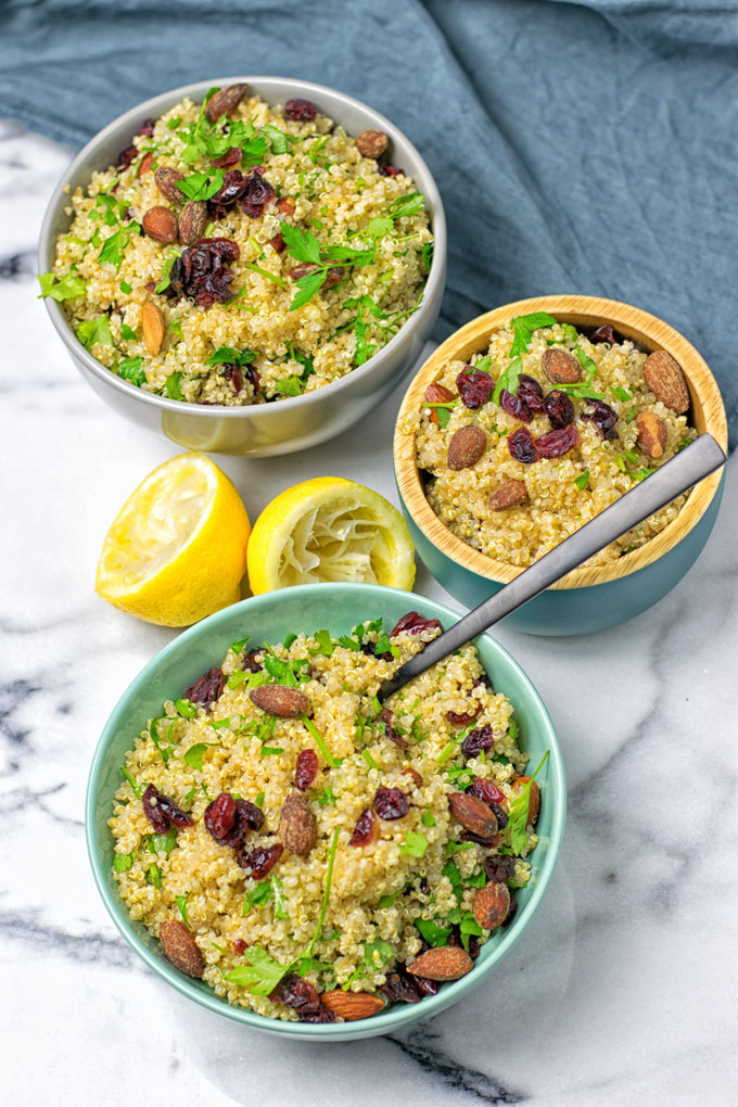 Bowls containing quinoa, nuts and raisins