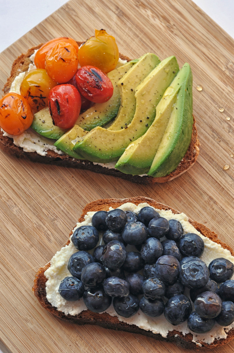 two slices of toast with healthy toppings