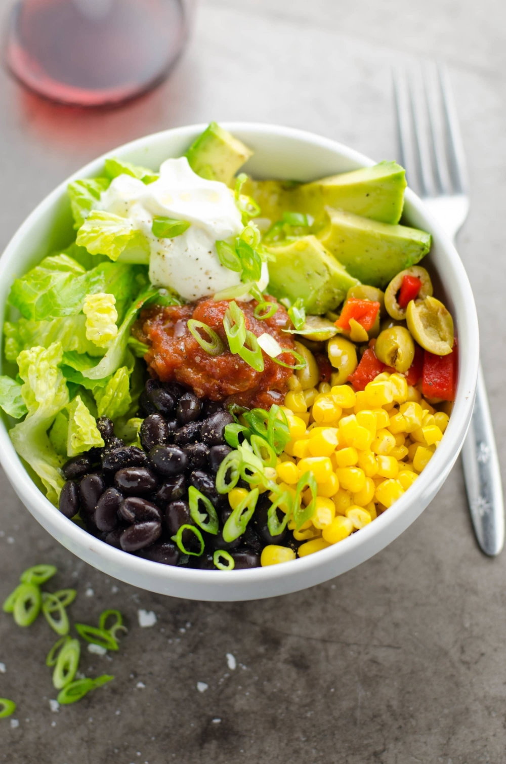 taco bowl with avocado, beans and sweetcorn