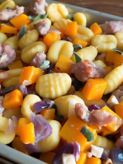 Roasted gnocchi recipe with butternut squash sausage meat onion and sage