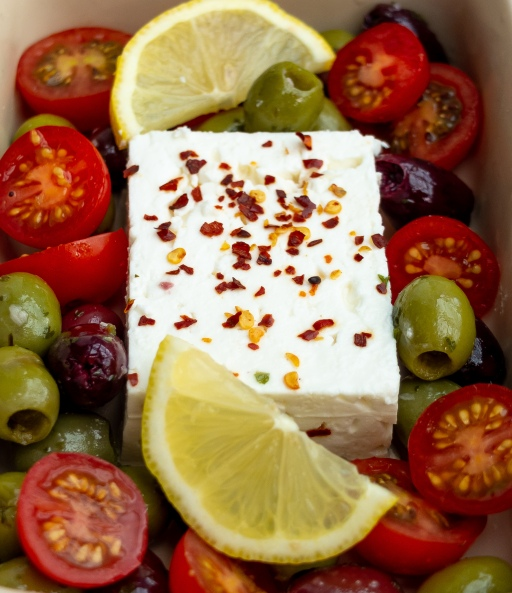 baked feta with lemon, olives and tomatoes
