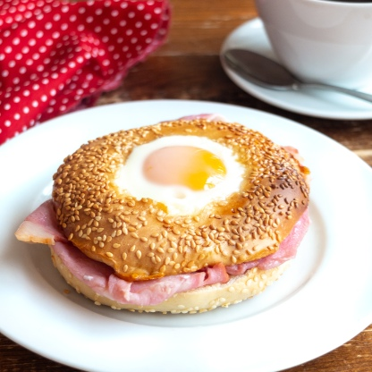 bagel on plate and coffee cup
